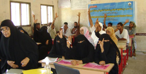 People put their hands up in a workshop in Aden