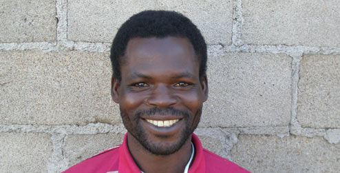 portrait of Christopher, a pastor in Chitungwiza, Zimbabwe