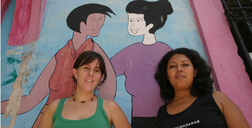 Two women outside women's rights organisation building in El Salvador