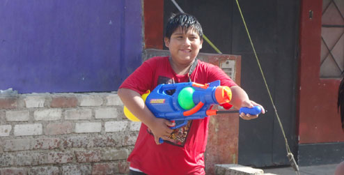 A boy in Peru during water carnival