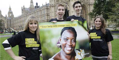 Young campaigners with a giant postcard for the UK Government