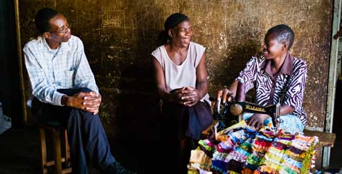 Development worker in Zimbabwe talks to two women