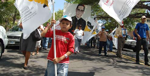 A child marching to commemorate Archbishop Oscar Romero in El Salvador
