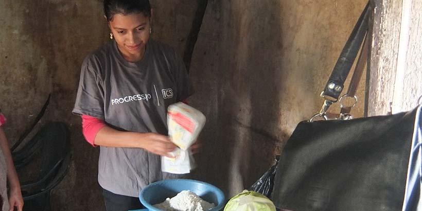 National volunteer Yakelin preparing the ingredients for the Enchiladas