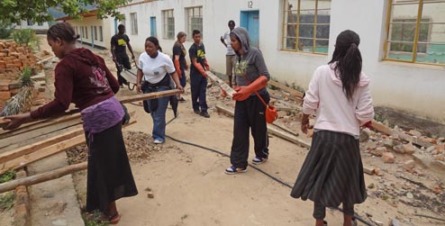 Volunteers fixing school