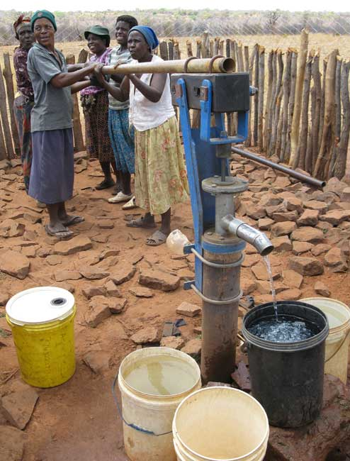 Women pumping water in Zimbabwe