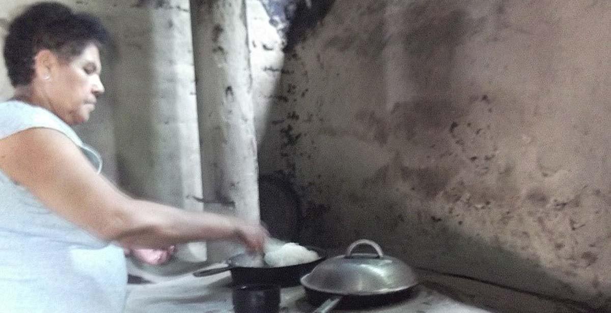Epifania cooking at her wood burning stove