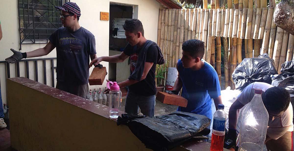 Volunteers recycling bottles