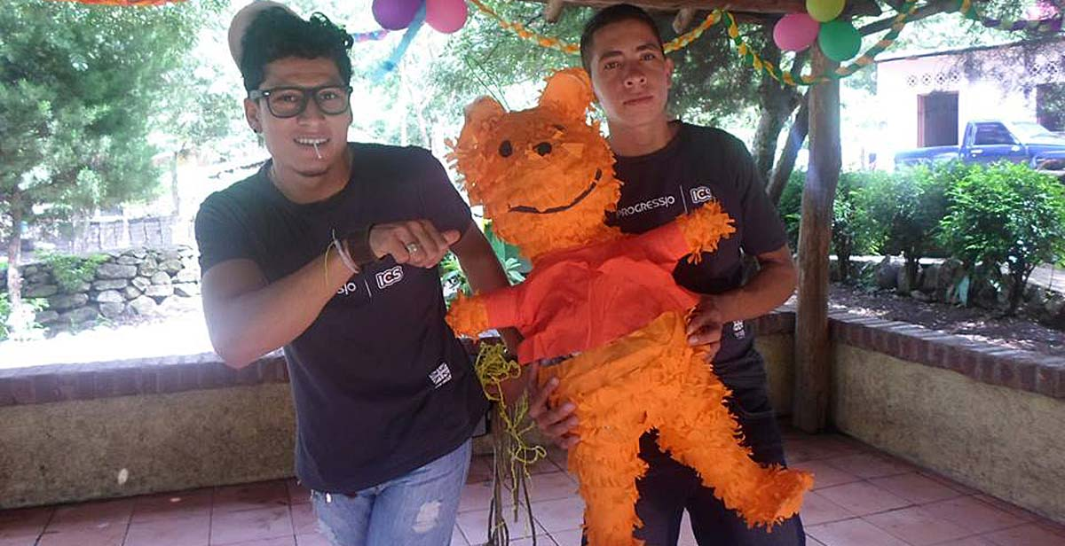 Volunteers with pinata