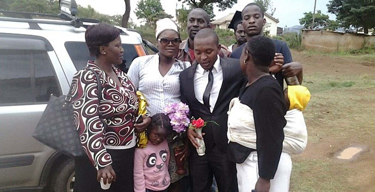 National Team Leader Raymond (in black suit) with his family