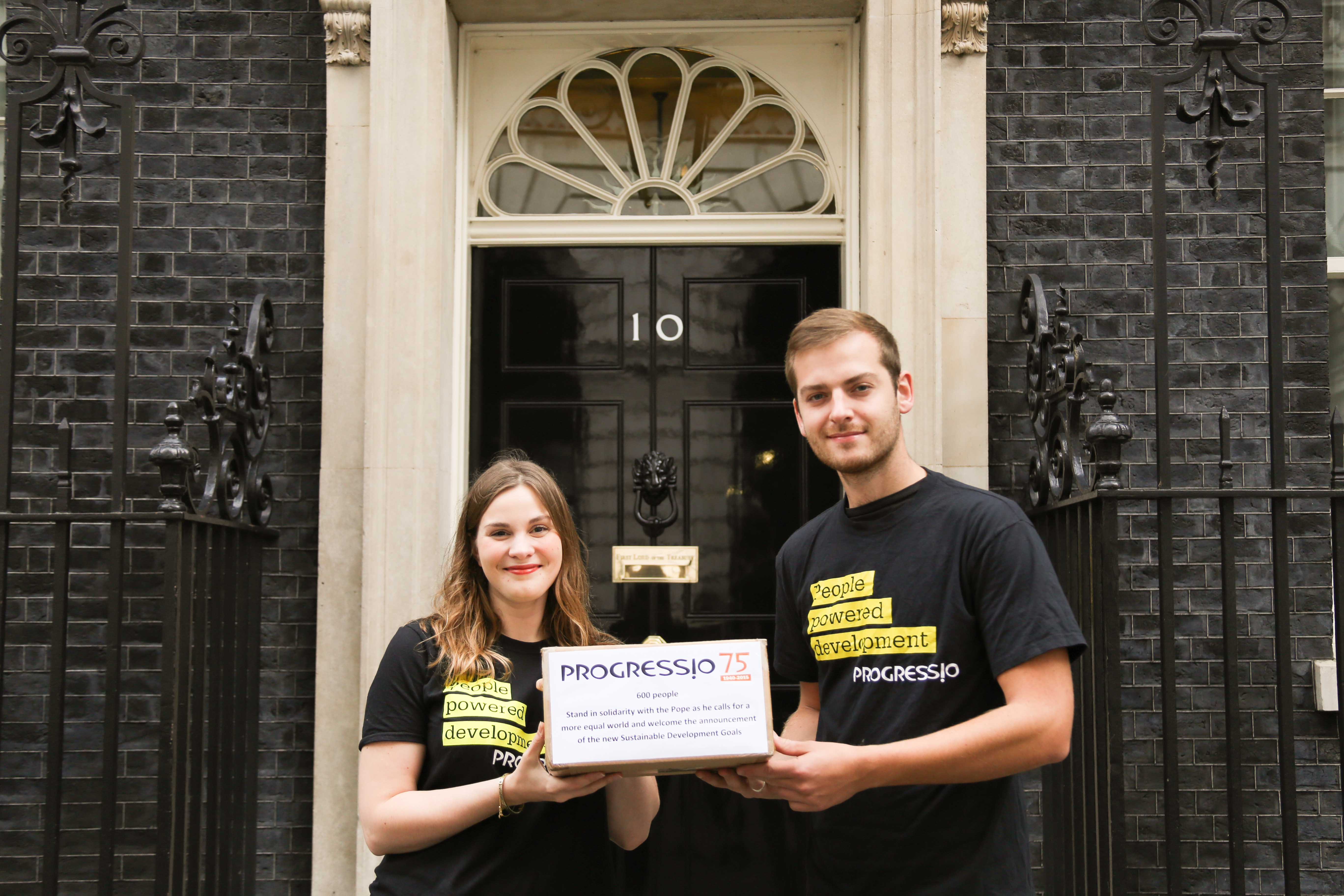 Campaigns Officer Jenny Vaughan and Action at Home Officer Seb Scott hand in petition to No 10