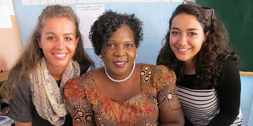 Kate and Ikram with their Amama (host mother) Mrs Gondwe after her public speaking talk