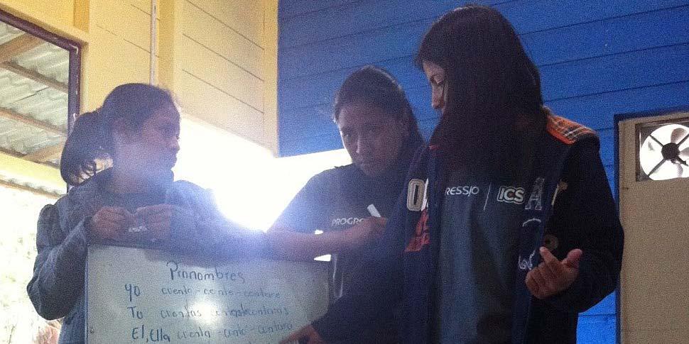 Honduran volunteers teaching UK volunteers Spanish