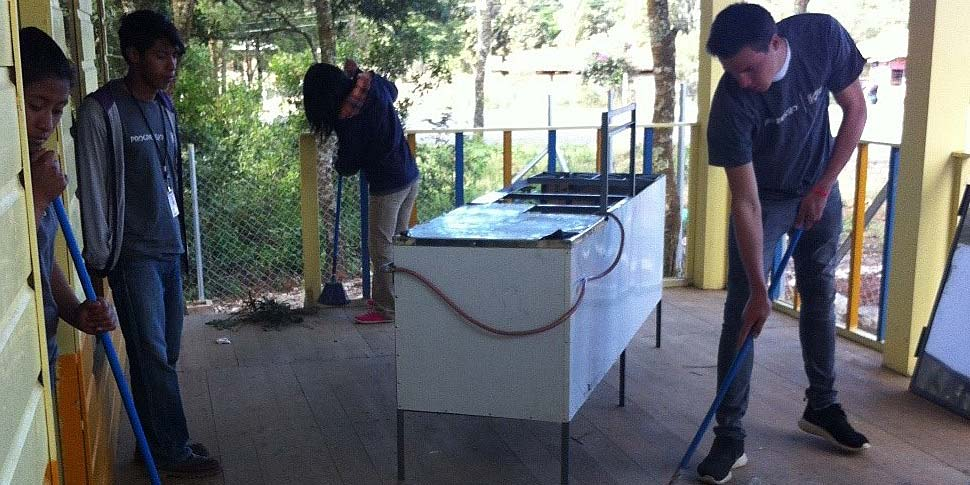 Volunteers cleaning up the café and moving in kitchen appliances