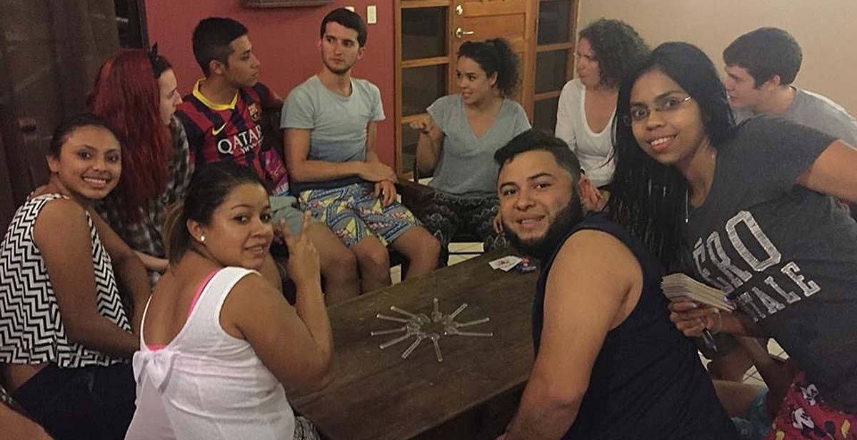 UK and national volunteers playing a game of spoons aka 'cuchara' during the orientation week.