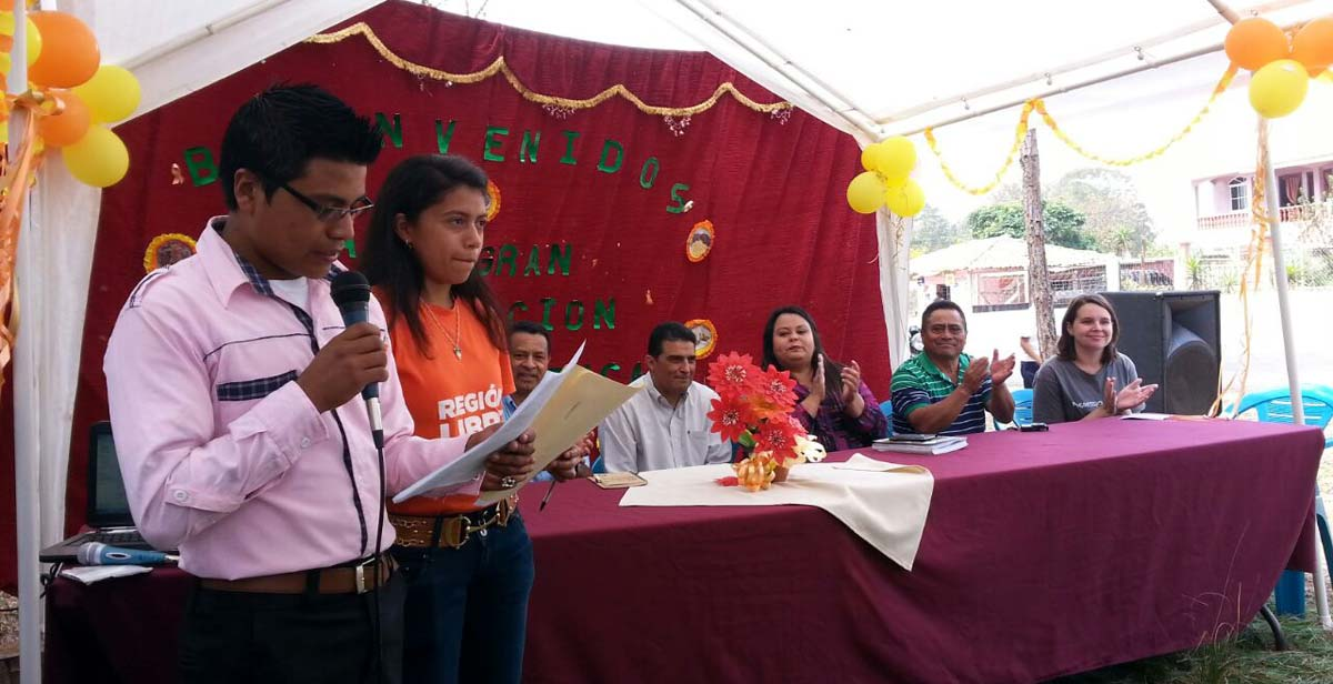 Josie on the head table at an event in Honduras (far right)