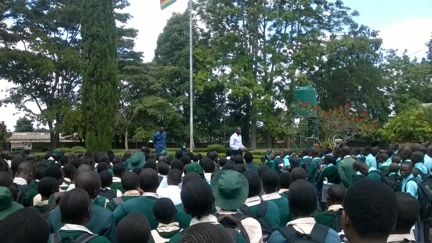 A man presents to a large crowd of school pupils