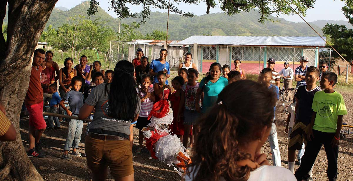 A game of piñata in the community