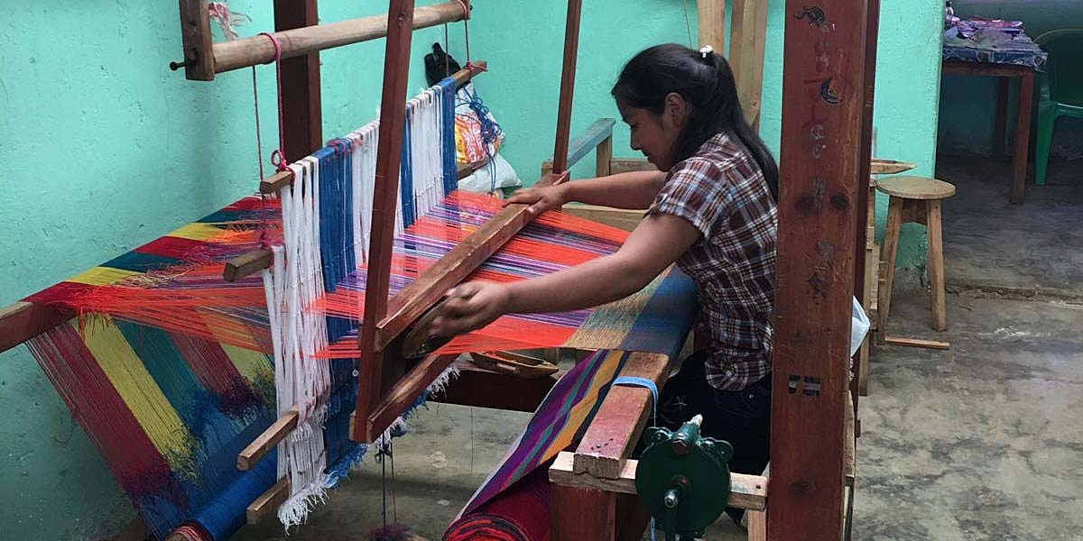 A Lenca woman at work, weaving traditionally Lenca-patterned fabric