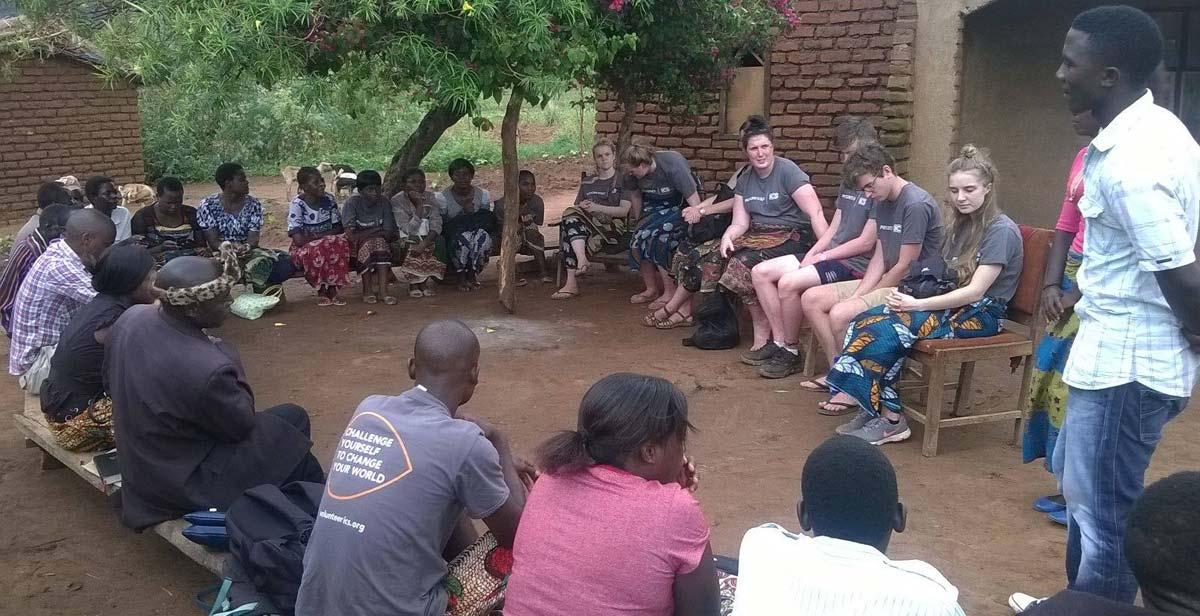 Volunteers meeting with village chief