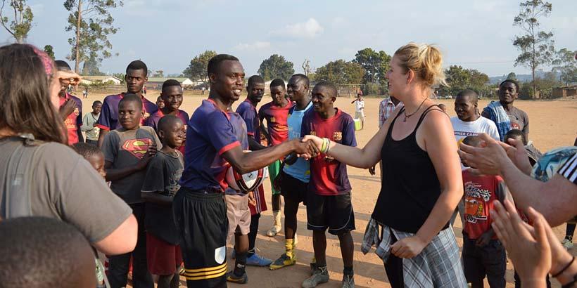 Emily congratulates the captain of Chibavi Rangers