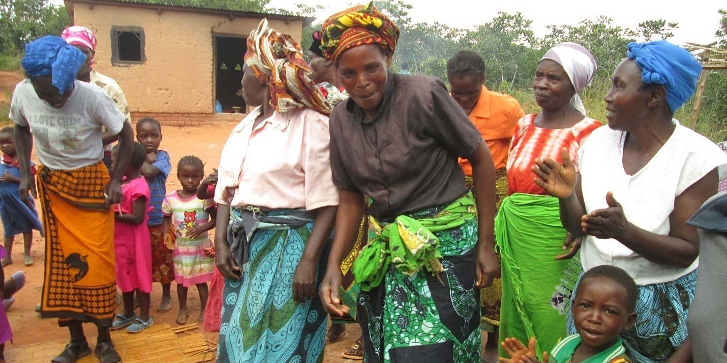 Some of the clay cook stove beneficiaries dance in delight