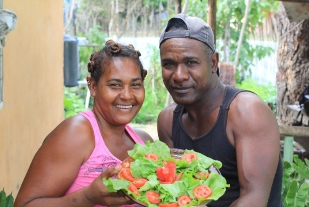 Margot and Rafael with the produce from his vegetable garden