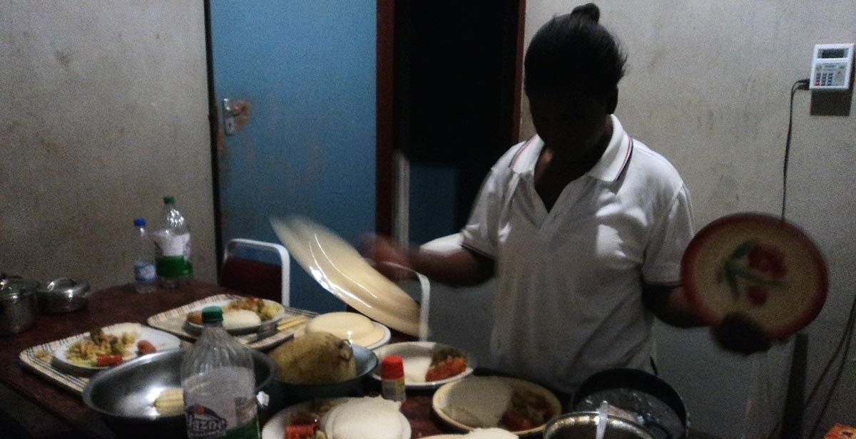 Helen's host mum preparing our delicious food