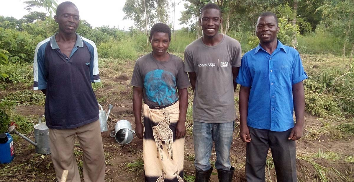 Mr Lombola (Village Development Committee Member) Village Headwoman Mwenyekasi, Peter Chidothe and Dan Lemani after planting trees at the village forest site