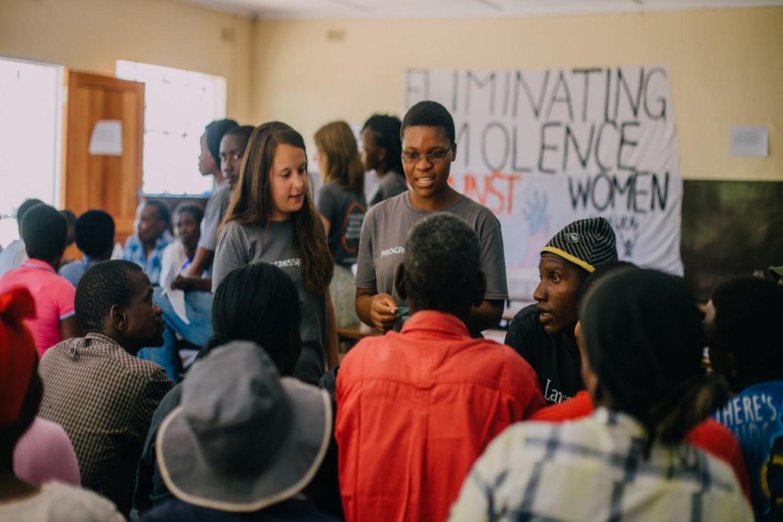Maria and her ICS volunteer team, running a workshop on ending violence against women