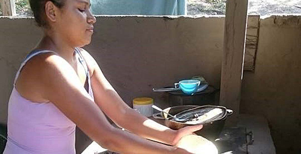 Sandra making tortillas on a new eco-stove