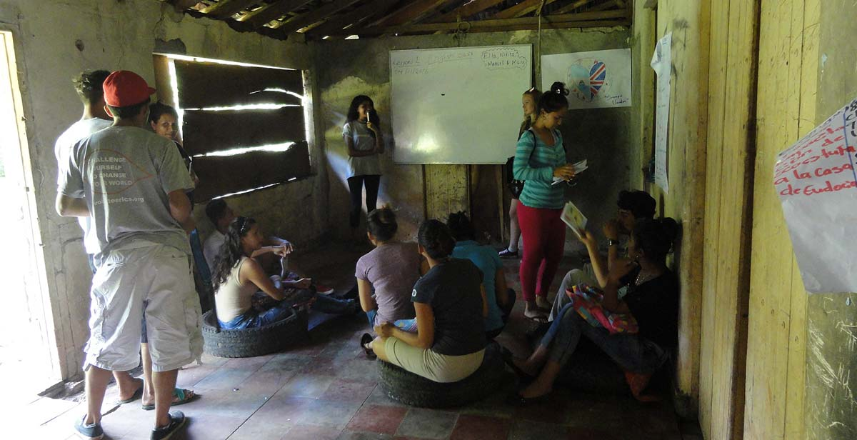 Volunteers giving an English class