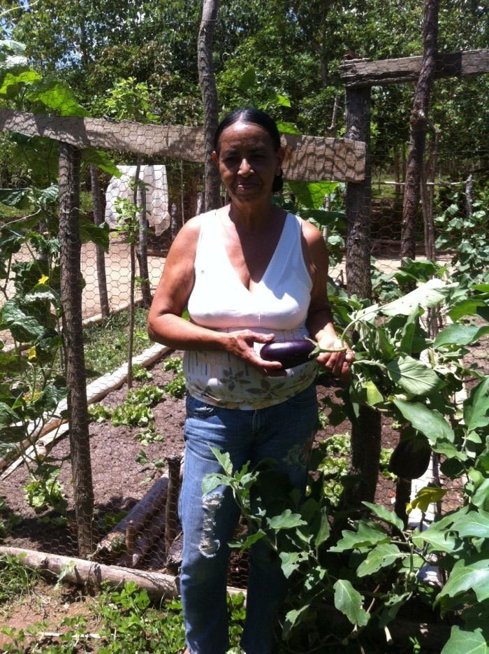 Ramona showing some of the produce in her vegetable garden