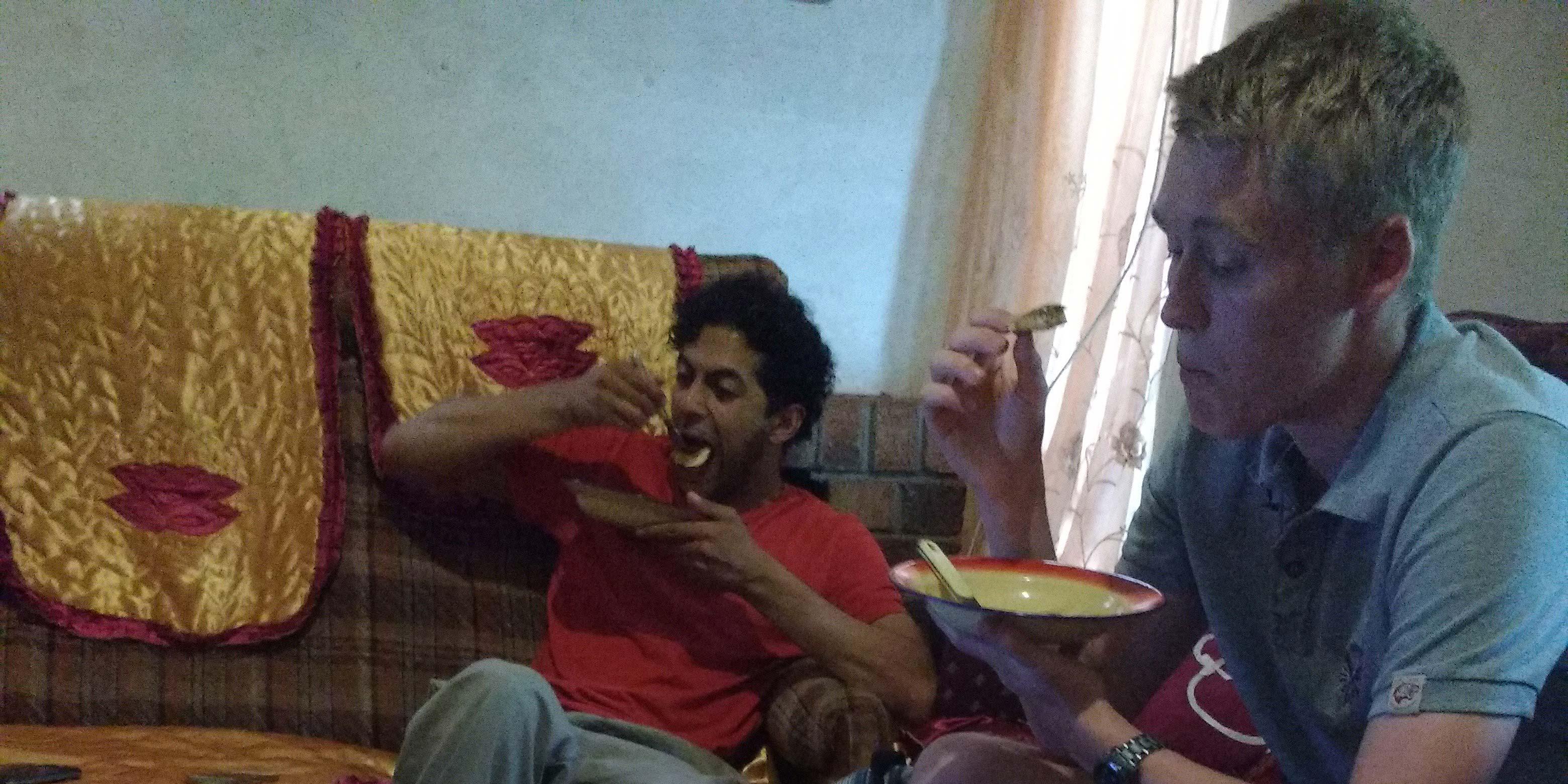Jack and Ahmad scoffing pancakes