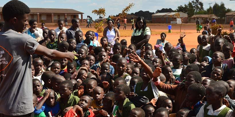 Gomez presenting to the primary school children