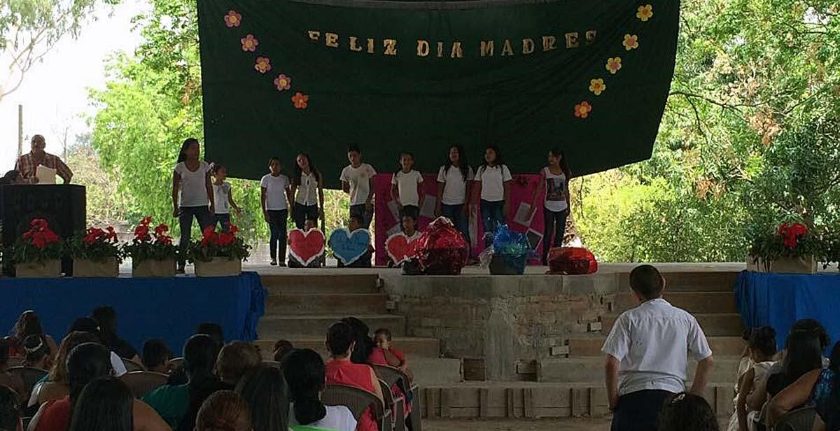 Glee Club performing centre stage during the school's Mother's Day celebrations