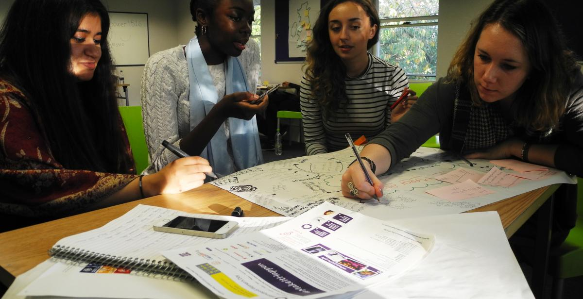 Volunteers Tamanna, Christina, Tara and Nicola plan campaigns actions around International Women's Day.