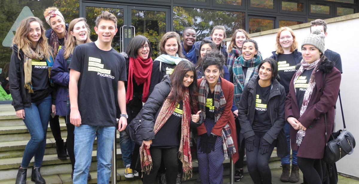 Empower volunteers gather outside hostel after a walk around York.