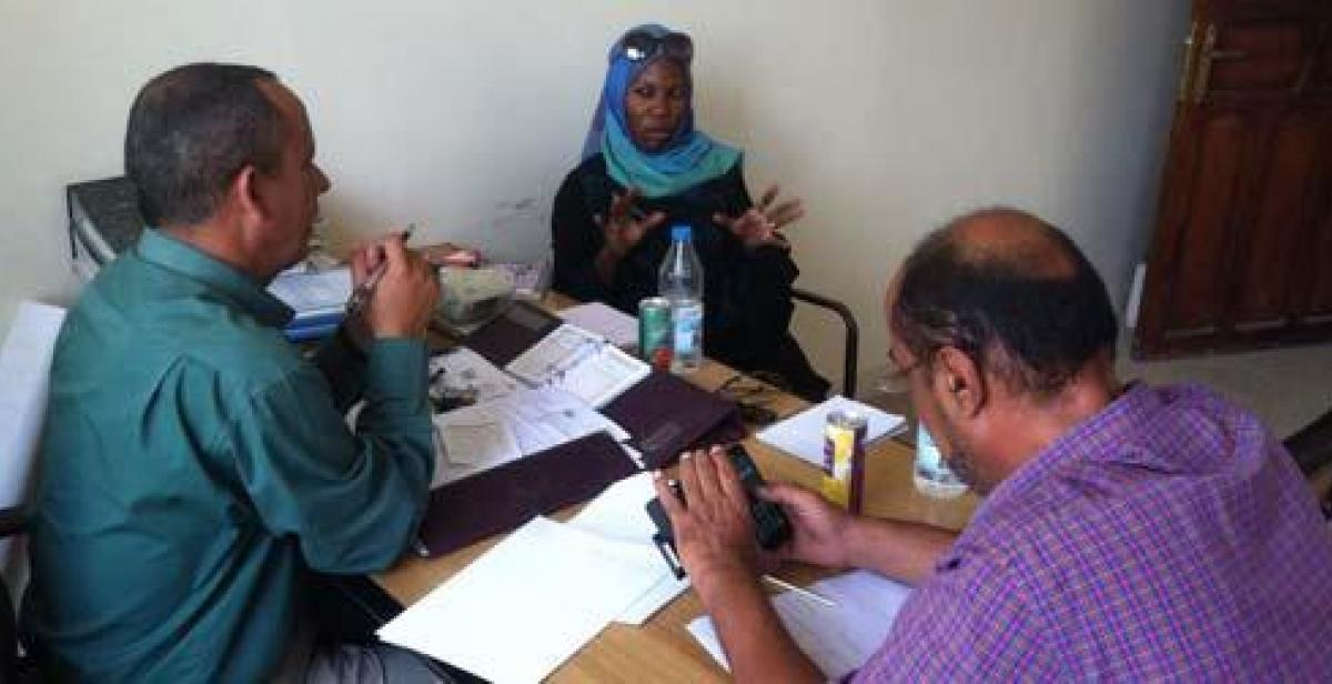 Sarah Kamya at a meeting with colleagues