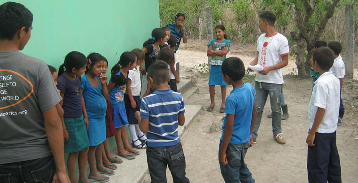 An English lesson supported by two national ICS volunteers