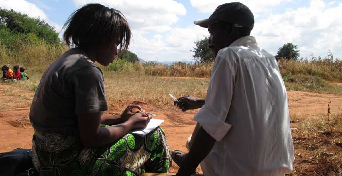 ICS volunteer Dorothy Mwalweni interviewing Mr. Raphael Nkosi