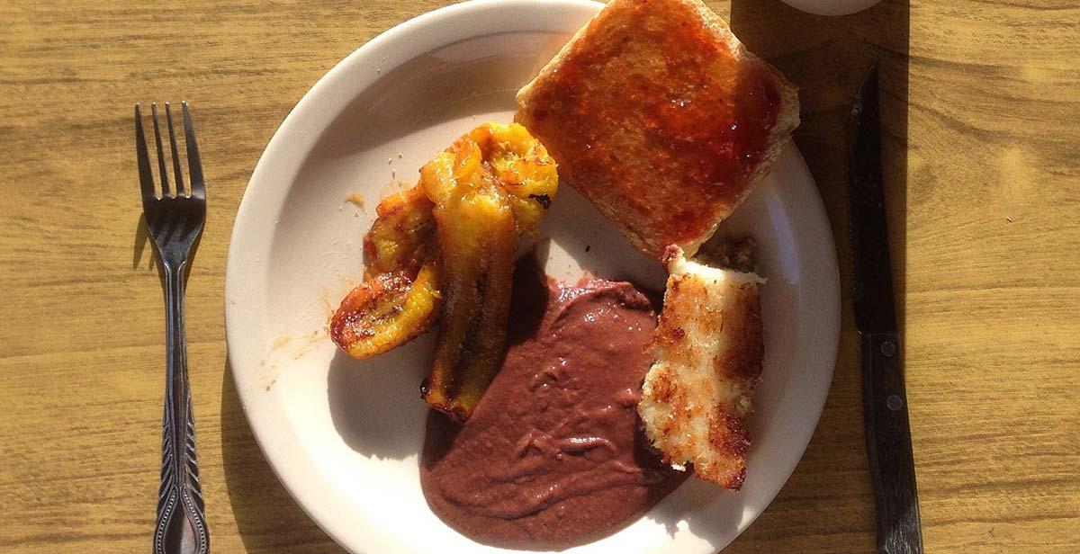 Breakfast - plantain, toast, frijoles and tamalito de elote