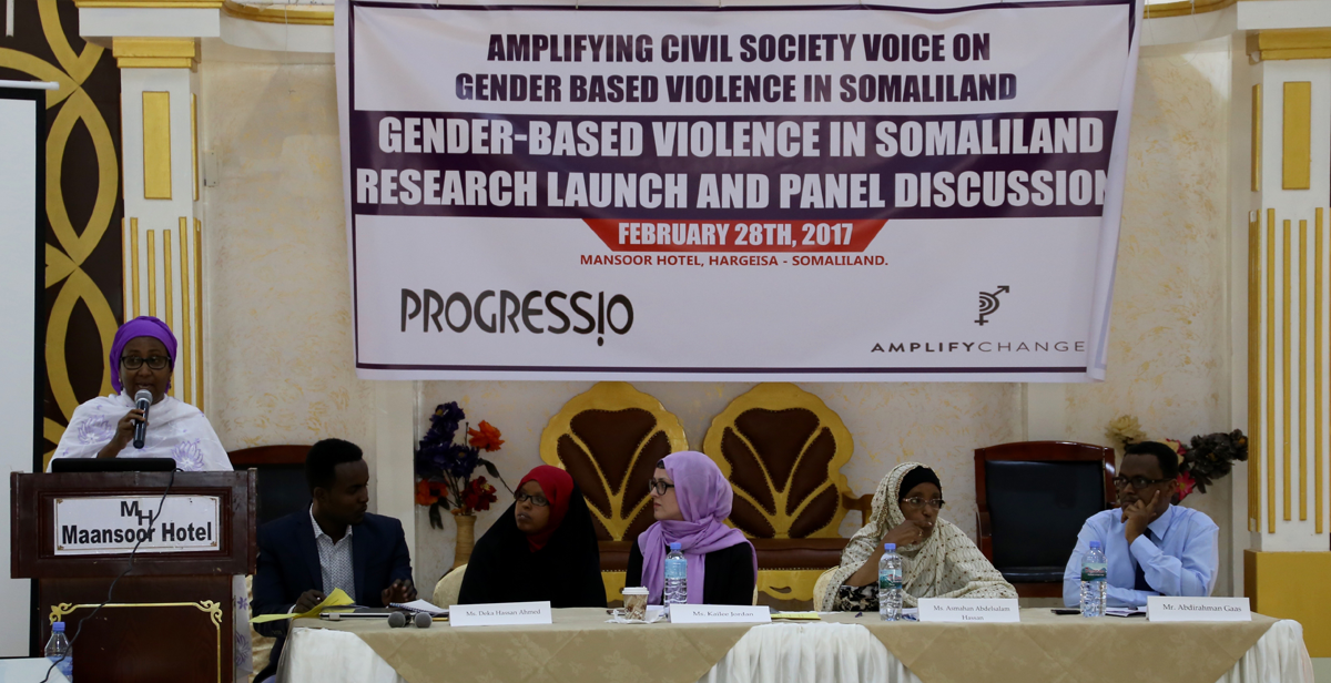 Kailee Jordan (middle of the group at the table), Progressio's Somaliland Country Representative and civil society members at the public launch of the 'Amplifying Civil Society Voice on Gender-Based Violence in Somaliland' research project, in Hargeisa
