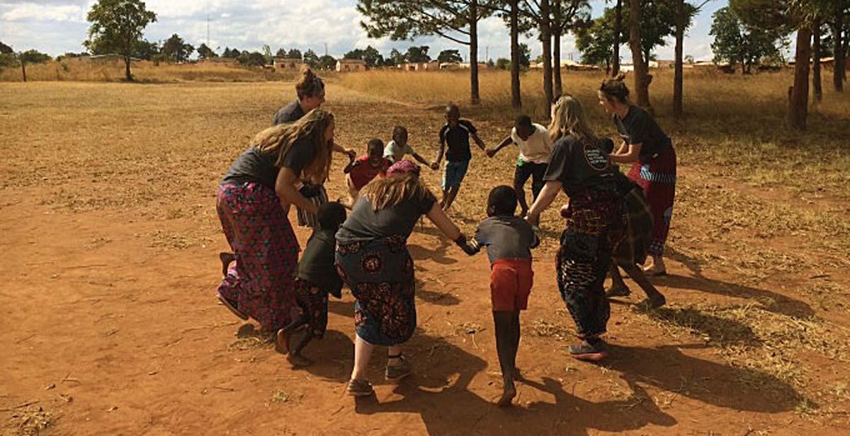 UK volunteers playing and singing songs with the children in Champhira