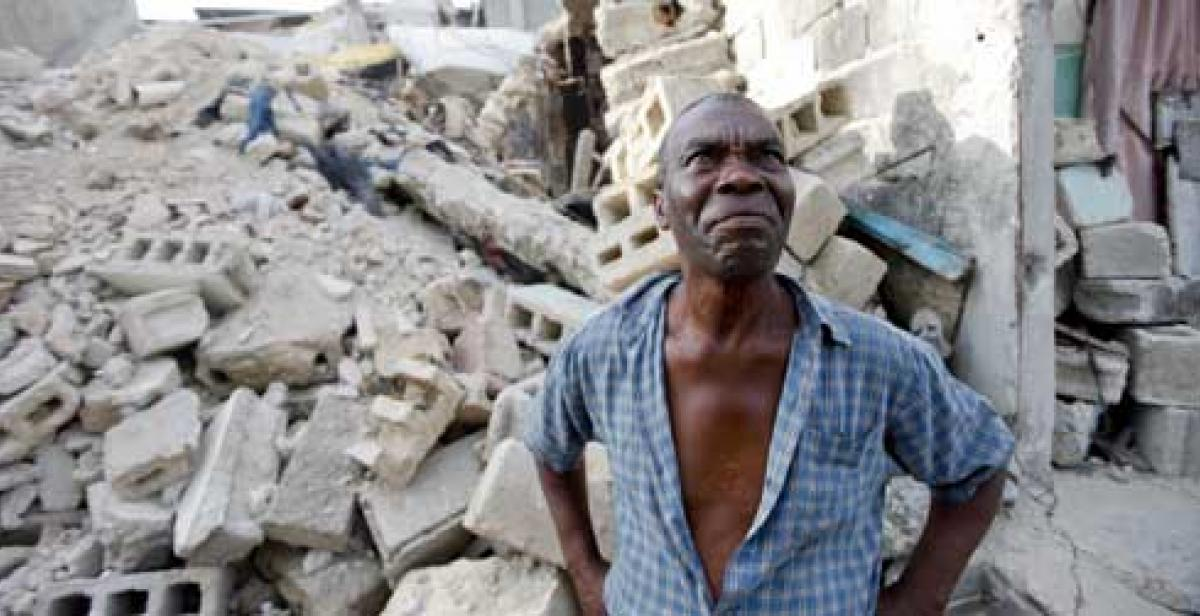 Wilbert Joseph surveys the rubble of his former home
