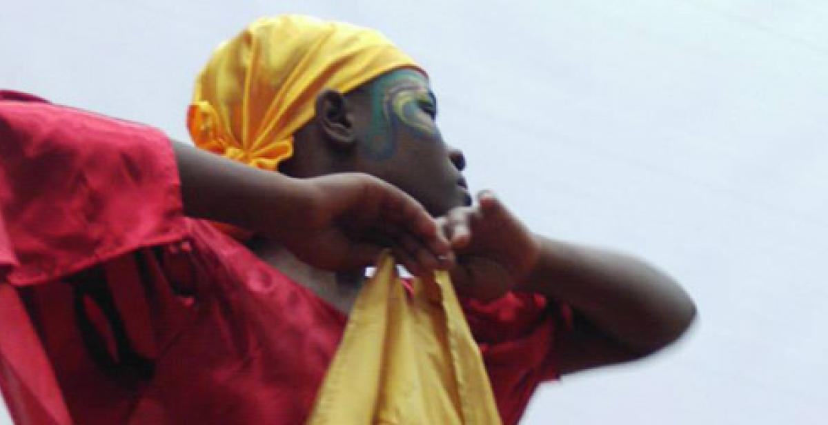 A member of the dance group Ayika performs