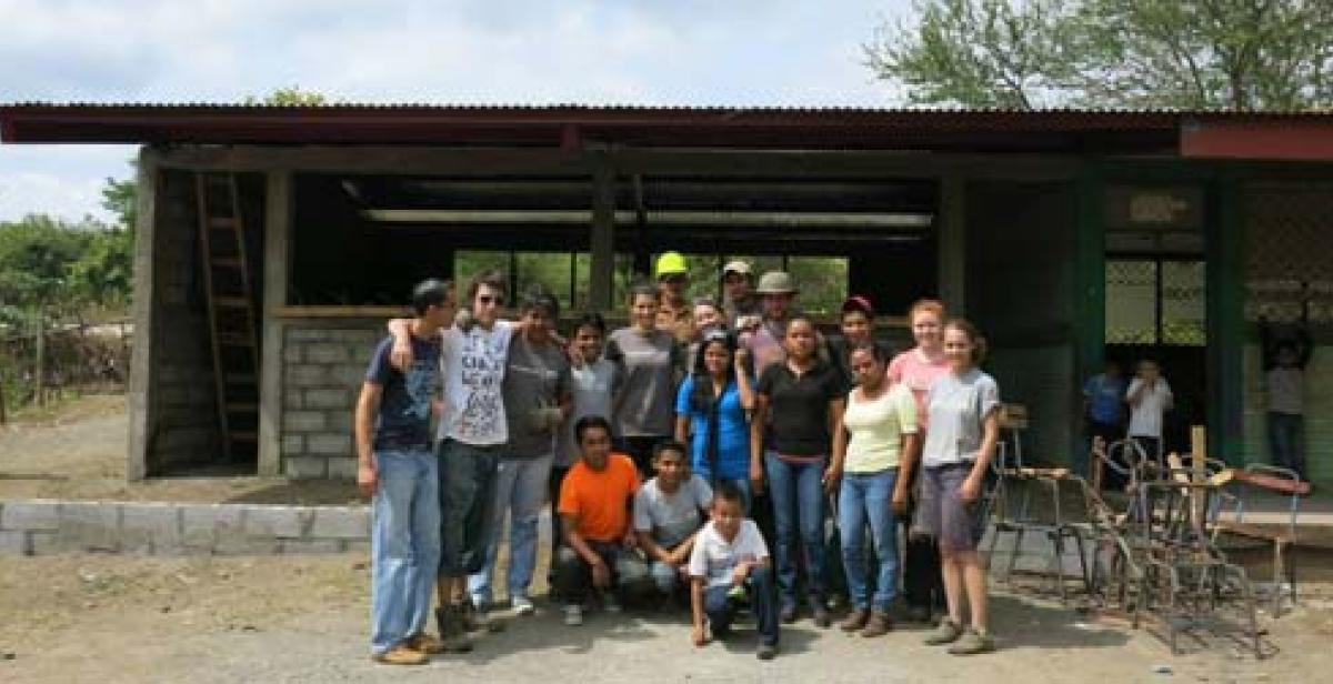 Team outside the finished classroom