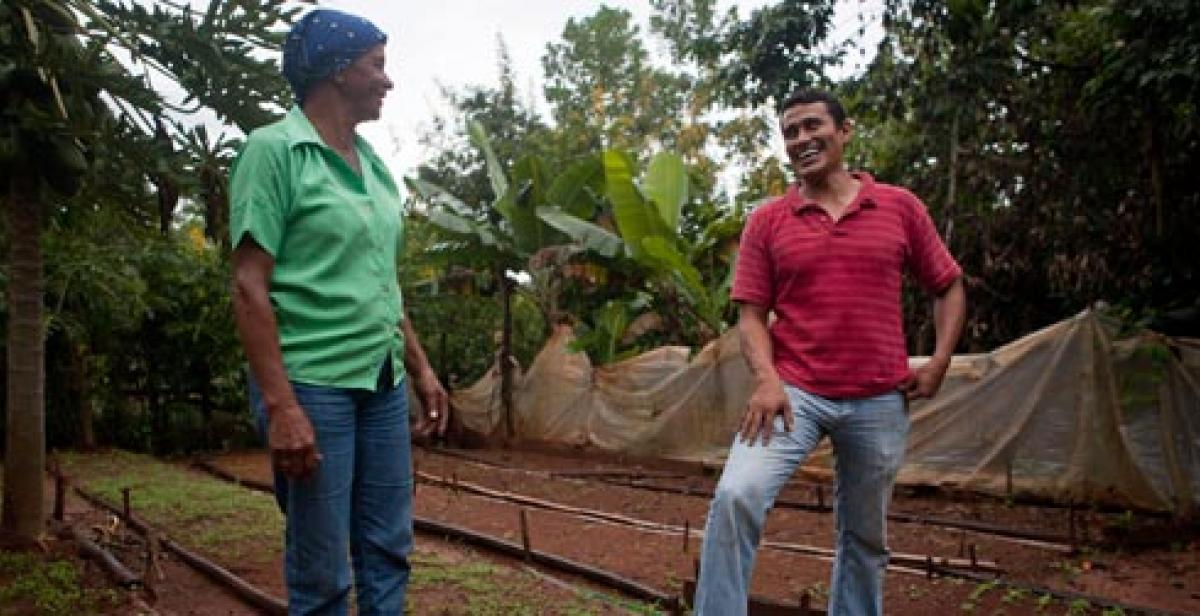 Amparo Jimenez and Bernardo Lopez in food garden