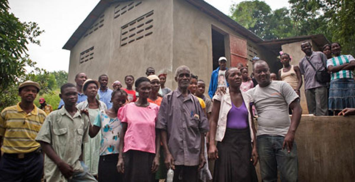 Villagers outside cassava factory in Gens de Nantes