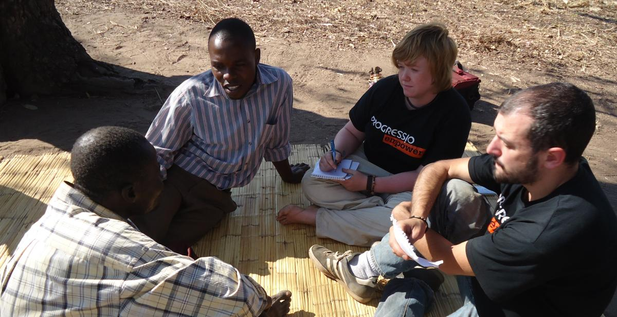 ICS volunteers talking with Malawian people